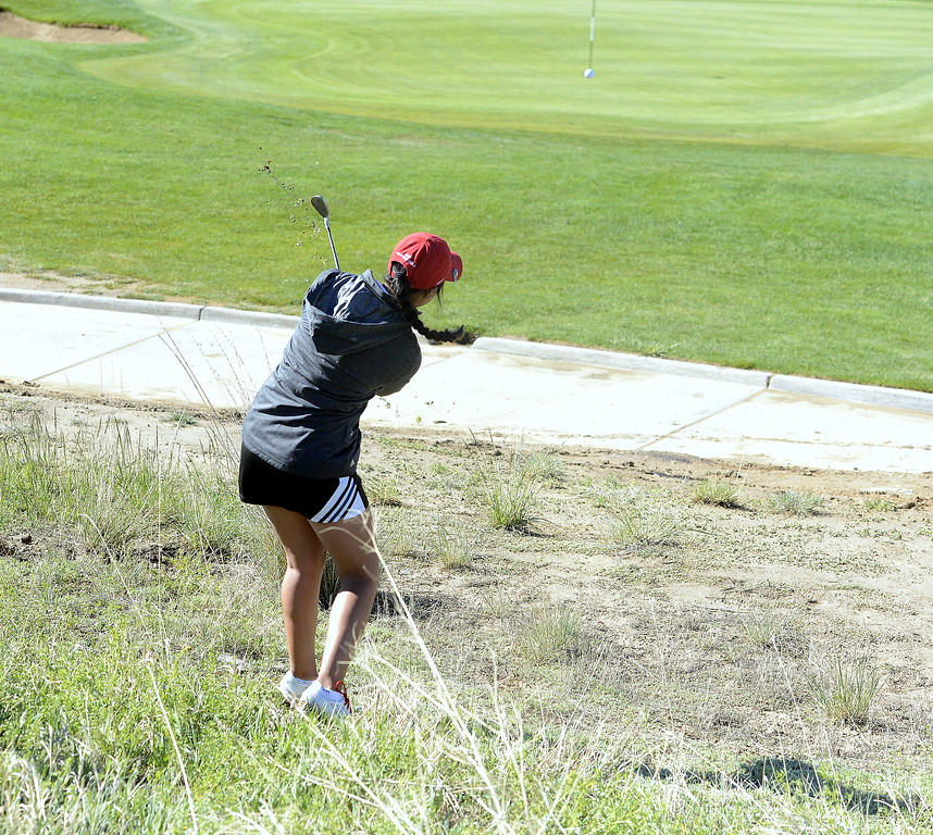 Loveland's Natalee Hall chips out of the mud during the second round of the 4A State Girls Golf Tournament on Tuesday at Colorado National Golf Club in Erie.