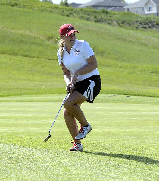 Loveland's Aili Bundy reacts as her putt for birdie on the 18th green slides past the hole during the second round of the 4A State Girls Golf Tournament on Tuesday at Colorado National Golf Club in Erie.