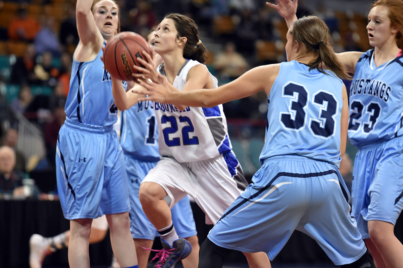 "Broomfield's Brenna Chase goes to the basket against Ralston Valley's' Sarah Bevington during the state 5A great eight  game at the Denver Coliseum on Friday.<br /> <br /> More photos:  <a href=""http://www.BoCoPreps.com"">http://www.BoCoPreps.com</a><br /> David R. Jennings/Staff Photographer<br /> March 4, 2016"