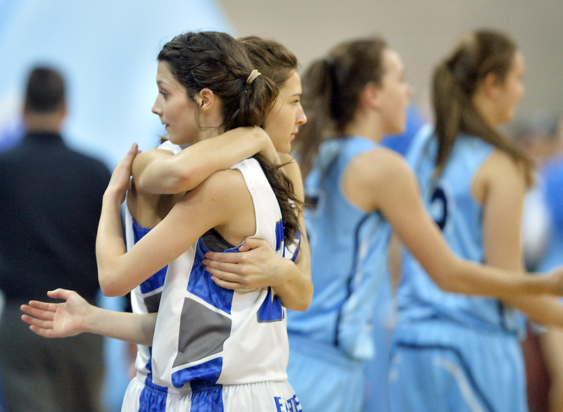 "Broomfield's Brenna Chase, right, is hugged by  teammate Jenna Casasanta as the Eagles lost to Ralston Valley's in the state 5A great eight  game at the Denver Coliseum on Friday.<br /> More photos:  <a href=""http://www.BoCoPreps.com"">http://www.BoCoPreps.com</a><br /> David R. Jennings/Staff Photographer<br /> March 4, 2016"