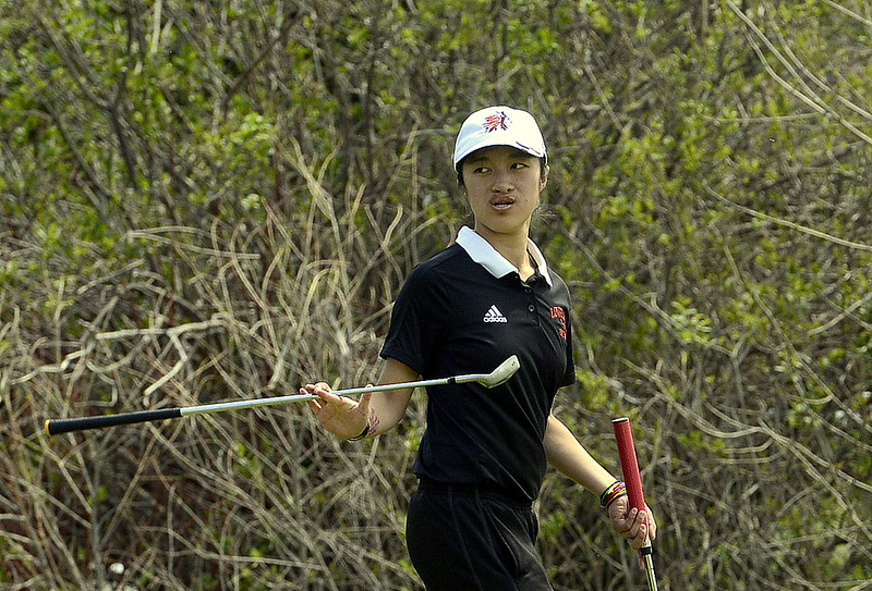 Haley Bradley of Loveland twirls her wedge in one hand as she walks to putt her ball  during Monday's Northern Conference league meet at the Olde Course in Loveland. She shot an 86.  (Mike Brohard/Loveland Reporter-Herald)