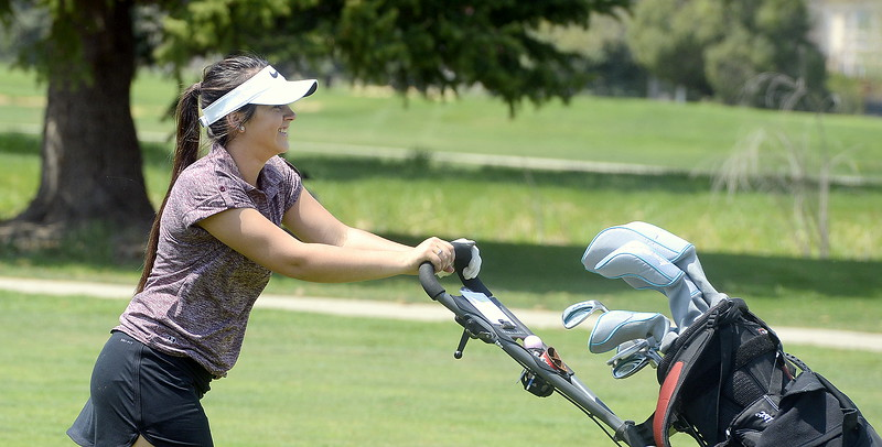 Berthoud's Cora Fate was all smiles after a good shot  during Monday's Northern Conference league meet at the Olde Course in Loveland. She finished with a personal-best 106. (Mike Brohard/Loveland Reporter-Herald)