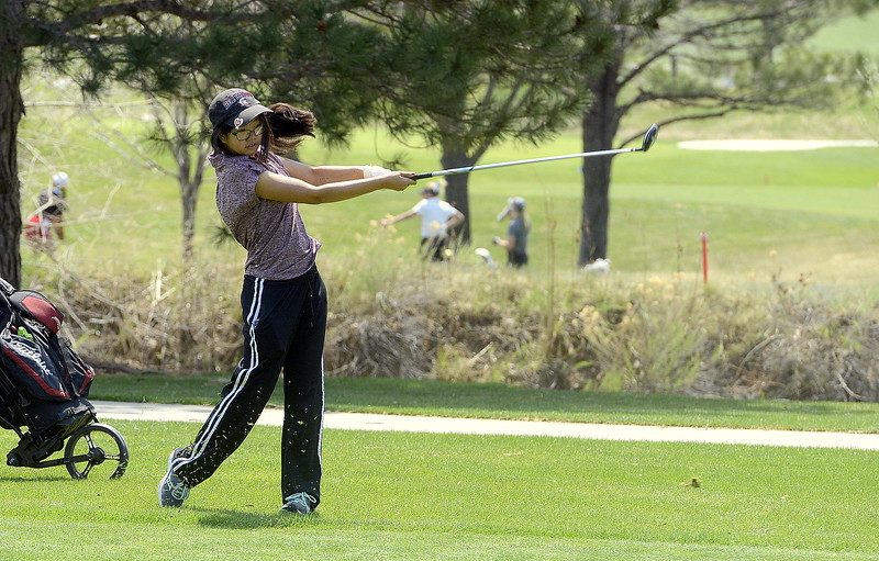 Rayna Nanto of Berthoud follows through with a fairway iron  during Monday's Northern Conference league meet at the Olde Course in Loveland. She shot a personal-best 116 for the round. (Mike Brohard/Loveland Reporter-Herald)