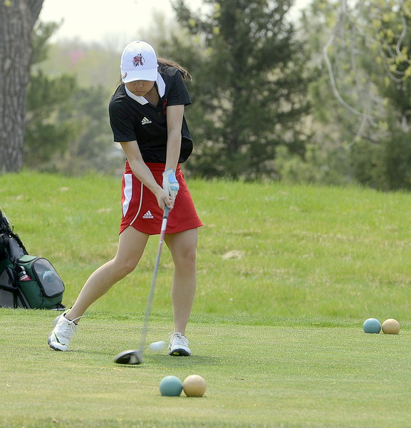 Loveland's Casey Bradley cuts loose on a tee shot  during Monday's Northern Conference league meet at the Olde Course in Loveland. She finished with a 90. (Mike Brohard/Loveland Reporter-Herald)