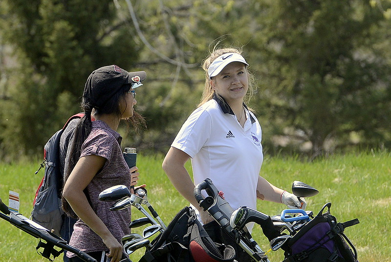 Mountain View's Ally Buckner (right) and Berthoud's Rayna Nanto chat as they wait to tee off during Monday's Northern Conference league meet at the Olde Course in Loveland. (Mike Brohard/Loveland Reporter-Herald)