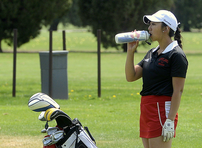 Loveland's Natalee Hall grabs some water as she waits for the group in front to clear off the green  during Monday's Northern Conference league meet at the Olde Course in Loveland. (Mike Brohard/Loveland Reporter-Herald)