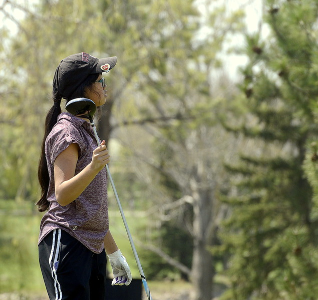 Berthoud's Rayna Nanto holds her driver after hitting off the tee  during Monday's Northern Conference league meet at the Olde Course in Loveland. (Mike Brohard/Loveland Reporter-Herald)