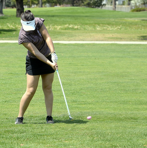 Cora Fate of Berthoud hits an approach shot  during Monday's Northern Conference league meet at the Olde Course in Loveland. (Mike Brohard/Loveland Reporter-Herald)