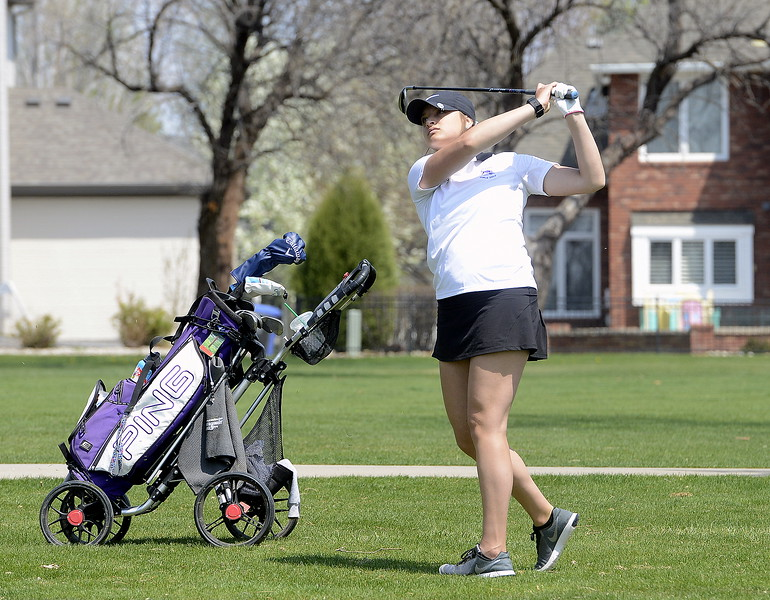 Mountain View's Camryn Polansky watches the flight of her shot during Monday's Northern Conference league meet at the Olde Course in Loveland. (Mike Brohard/Loveland Reporter-Herald)
