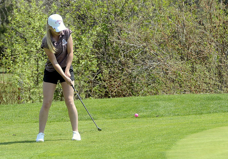 Stephanie Haberkon chips onto the green  during Monday's Northern Conference league meet at the Olde Course in Loveland. She carded her best round with a 109. (Mike Brohard/Loveland Reporter-Herald)