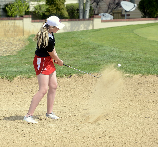 Loveland's Taylor Bandemer blasts out the green-side bunker on No. 10  during Monday's Northern Conference league meet at the Olde Course in Loveland. (Mike Brohard/Loveland Reporter-Herald)