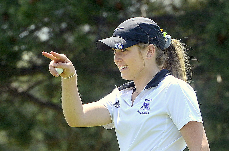 Mountain View's Renee Demaree jokes with an opposing coach she's watching him after finishing Monday's round at the Olde Course by sinking a birdie putt on 18 during a Northern Conference league meet. (Mike Brohard/Loveland Reporter-Herald).