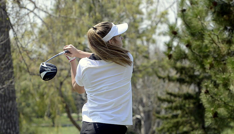 Mountain View's Ally Buckner tracks her tee shot during Monday's Northern Conference league meet at the Olde Course in Loveland. (Mike Brohard/Loveland Reporter-Herald)