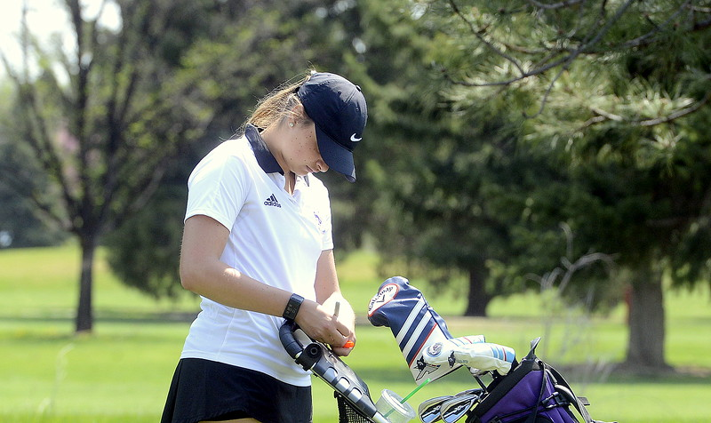 Camyrn Polanski of Mountain View writes in her score during Monday's Northern Conference league meet at the Olde Course in Loveland. Polansky fired a round of 89 on the day. (Mike Brohard/Loveland Reporter-Herald)