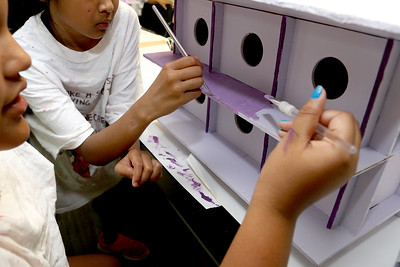 The girls at Girls Inc. Painted Purple Martin Birdhouses with the theme Safe Homes on Friday afternoon in Lowell.  These will be auctioned off at the Mahoney Tribute on October 19th. The Mahoney Tribute remembers the family of Maureen Mahoney, who were murdered in Tewksbury in 1975. SUN/JOHN LOVE