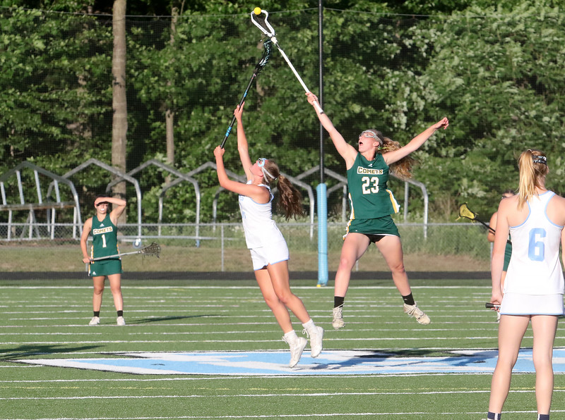 BFA's Sophie Zemianek elevates and steals a faceoff during the Comets 17-6 loss to South Burlington in the D1 State Championship on Wednesday night at SBHS.