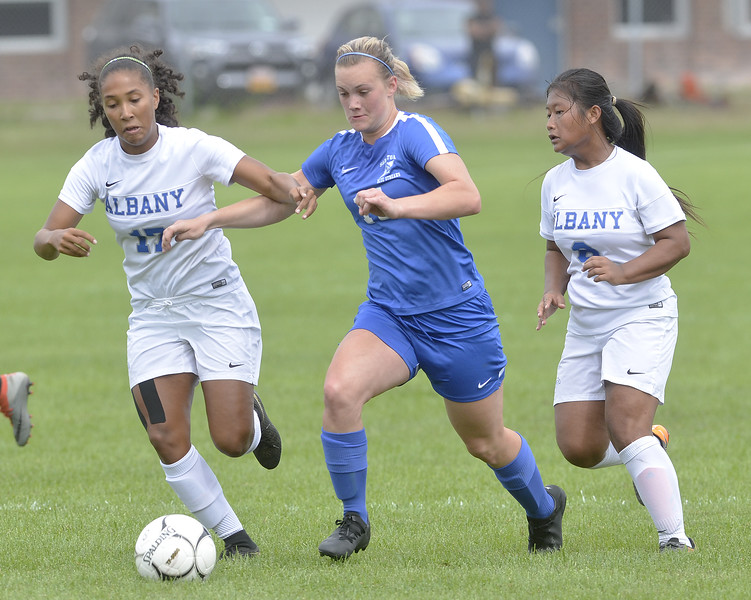 STAN HUDY - SHUDY@DIGITALFIRSTMEDIA.COM<br /> Saratoga Springs senior defender Rory Taylor splits Albany High defenders Kennedy Jones (left) and Myane Aung (right) in the second half of their Suburban Council contest.
