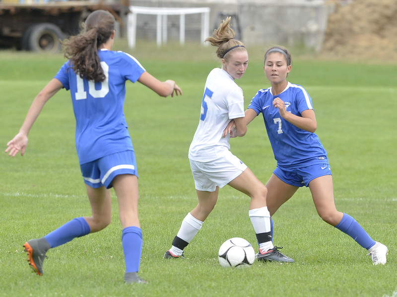 STAN HUDY - SHUDY@DIGITALFIRSTMEDIA.COM<br /> Saratoga Springs midfielder Leah Radovic looks to break away from Albany's Alison Hayes during Saturday morning's Suburban Council clash with Helena Bartlett (10) arriving.