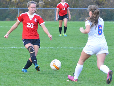 KYLE MENNIG - ONEIDA DAILY DISPATCH Vernon-Verona-Sherrill's Emily Rossi (20) kicks the ball upfield past Oneida's Julia Abel (6) during their Section III Class B playoff match in Oneida on Tuesday, Oct. 18, 2016.