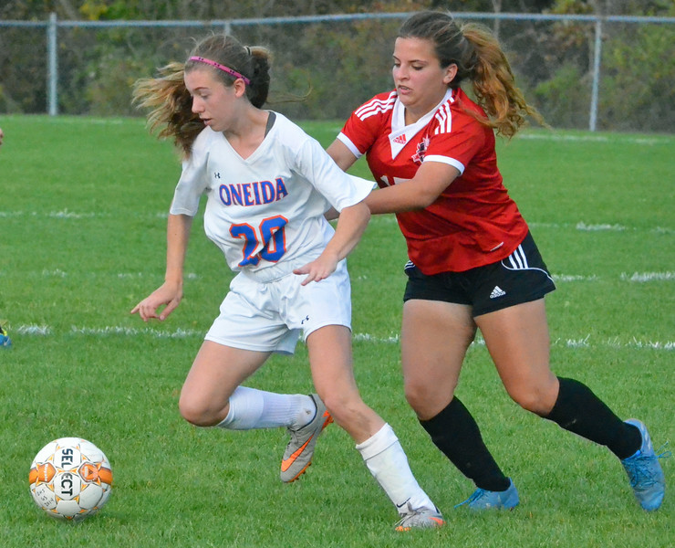 KYLE MENNIG - ONEIDA DAILY DISPATCH Oneida's Rachel DeRuby (20) dribbles the ball away from Vernon-Verona-Sherrill's Abbey D'Agostino (17) during their Section III Class B playoff match in Oneida on Tuesday, Oct. 18, 2016.