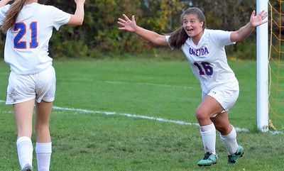 KYLE MENNIG - ONEIDA DAILY DISPATCH Oneida's Kayla Suppa (16) and Sarah Paul (21) celebrate after Suppa's overtime goal against Vernon-Verona-Sherrill in their Section III Class B playoff match in Oneida on Tuesday, Oct. 18, 2016.