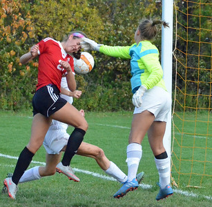KYLE MENNIG - ONEIDA DAILY DISPATCH Vernon-Verona-Sherrill's Alexa Kiser (21) heads the ball on a corner kick as Oneida keeper Liz Rice reaches for it during their Section III Class B playoff match in Oneida on Tuesday, Oct. 18, 2016.