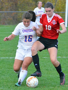 KYLE MENNIG - ONEIDA DAILY DISPATCH Oneida's Kayla Suppa (16) and Vernon-Verona-Sherrill's Sarah Wayland-Smith (18) battle for control of the ball during their Section III Class B playoff match in Oneida on Tuesday, Oct. 18, 2016.