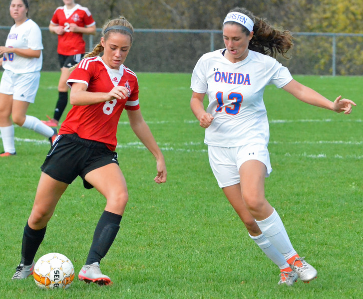 KYLE MENNIG - ONEIDA DAILY DISPATCH Vernon-Verona-Sherrill's Emma Lehmann (8) controls the ball as Oneida's Kirsten Barrett (13) defends during their match in Verona on Thursday, Sept. 29, 2016.