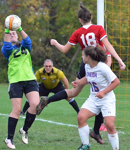 KYLE MENNIG - ONEIDA DAILY DISPATCH Vernon-Verona-Sherrill keeper Samantha Bentley (24) parries the ball following an Oneida corner kick during their Section III Class B playoff match in Oneida on Tuesday, Oct. 18, 2016. Looking on are Oneida's Kayla Suppa (16) and VVS' Sarah Wayland-Smith (18).