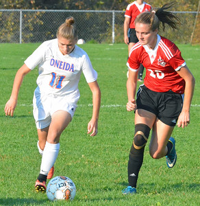 KYLE MENNIG - ONEIDA DAILY DISPATCH Oneida's Victoria Borders (11) brings the ball up the sideline as Vernon-Verona-Sherrill's Emily Rossi (20) in their Section III Class B playoff match in Oneida on Tuesday, Oct. 18, 2016.