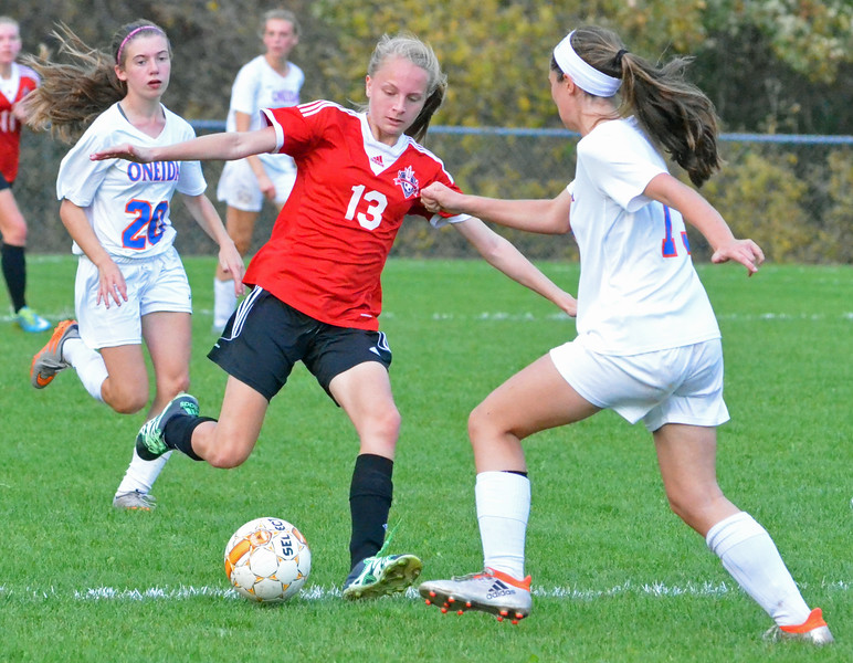 KYLE MENNIG - ONEIDA DAILY DISPATCH Vernon-Verona-Sherrill's Meghan Starke (13) kicks the ball as Oneida's Kirsten Barrett (13) defends during their Section III Class B playoff match in Oneida on Tuesday, Oct. 18, 2016.
