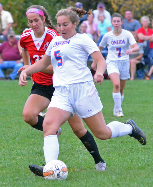 KYLE MENNIG - ONEIDA DAILY DISPATCH Oneida's Gabrielle Cafalone (5) kicks the ball up the field away from Vernon-Verona-Sherrill's Alexa Kiser (21) in their Section III Class B playoff match in Oneida on Tuesday, Oct. 18, 2016.