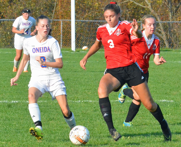 KYLE MENNIG - ONEIDA DAILY DISPATCH Vernon-Verona-Sherrill's Katja Meyer (3) moves with the ball as Oneida's Jenna Ford (3) defends during their Section III Class B playoff match in Oneida on Tuesday, Oct. 18, 2016.