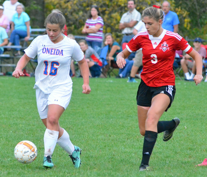 KYLE MENNIG - ONEIDA DAILY DISPATCH Oneida's Kayla Suppa (16) possesses the ball as Vernon-Verona-Sherrill's Katja Meyer (3) moves in to defend during their Section III Class B playoff match in Oneida on Tuesday, Oct. 18, 2016.