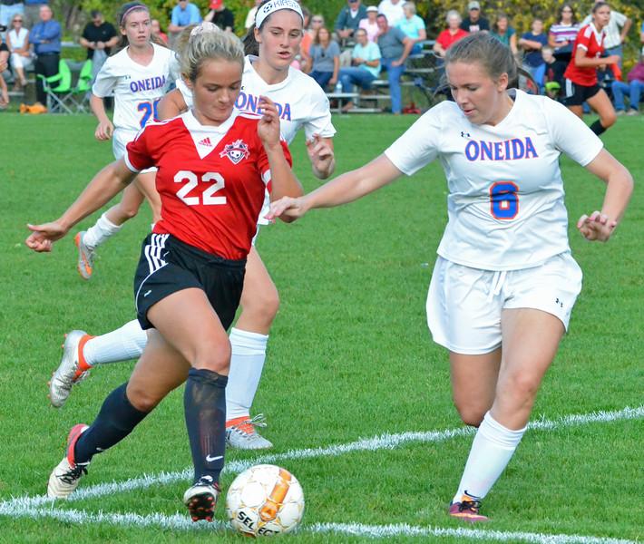 KYLE MENNIG - ONEIDA DAILY DISPATCH Vernon-Verona-Sherrill's Katie Musacchio (22) moves the ball towards the goal as Oneida's Julia Abel (6) defends during their match in Verona on Thursday, Sept. 29, 2016.