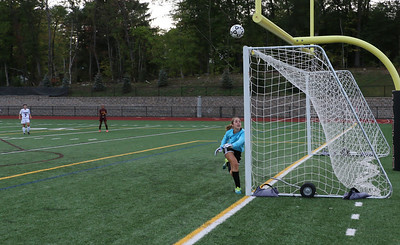 Abigail Treacy defends her net.  Photo by John Fitts