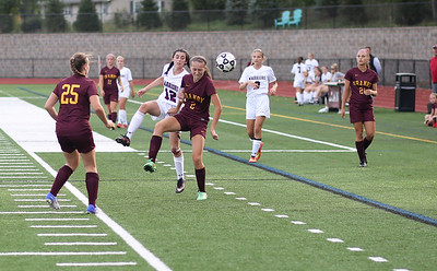 Rachel Kadis of Granby is closely guarded by Canton's Sofia Langou.  Photo by John Fitts