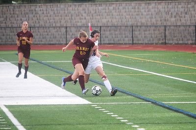 Granby's Mackenzie Stahl and Canton's Sofia Langou battle for control.  Photo by John Fitts