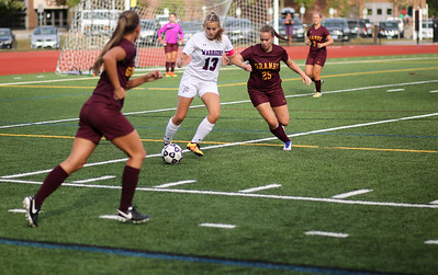 Devin Kadis controls for Canton but is challenged by Granby's Mackenzie Stahl.  Photo by John Fitts