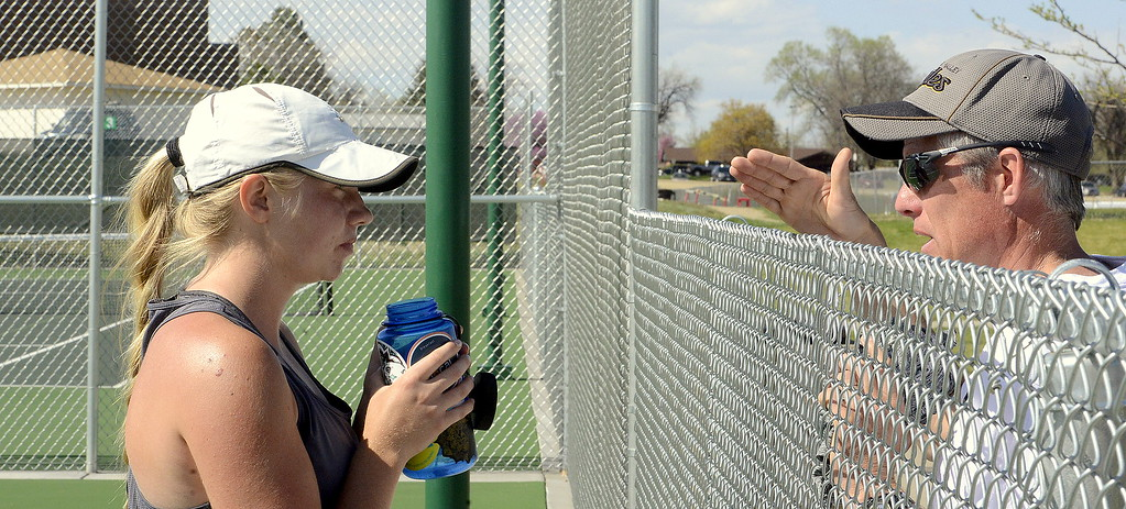 . Thompson Valley No. 1 singles player Maddie Sheets listens to coach Jay Klagge during a changeover in her championship match Friday at the 4A Region 4 tournament at North Lake Park. (Mike Brohard/Loveland Reporter-Herald)