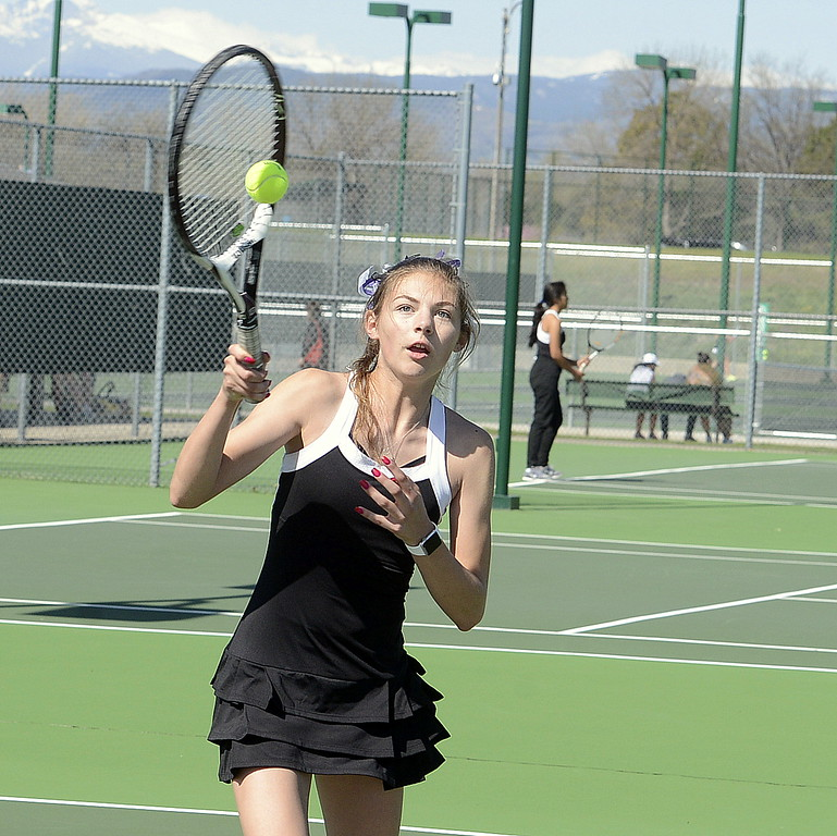 . Mountain View No. 2 doubles player Karmin Whipple keeps her eye on the ball Friday during the 4A Region 4 tournament at North Lake Park. (Mike Brohard/Loveland Reporter-Herald)