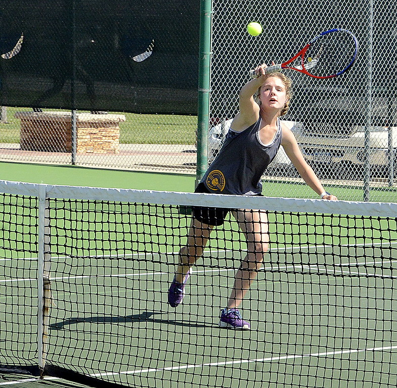 . Thompson Valley\'s Emily Black returns a shot at the net Friday during the No. 2 doubles championship match at the 4A Region 4 tournament at North Lake Park. (Mike Brohard/Loveland Reporter-Herald)