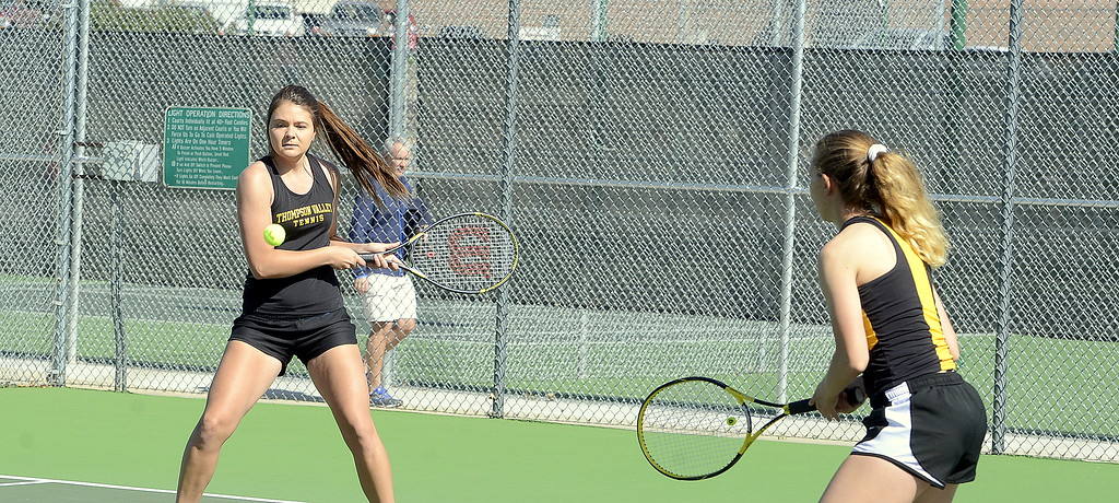 . Thompson Valley No. 3 doubles player Lacy Sauer (right) looks on as partner Kaelyn Giefer hits a return Friday at the 4A Region 4 tournament at North Lake Park. (Mike Brohard/Loveland Reporter-Herald)