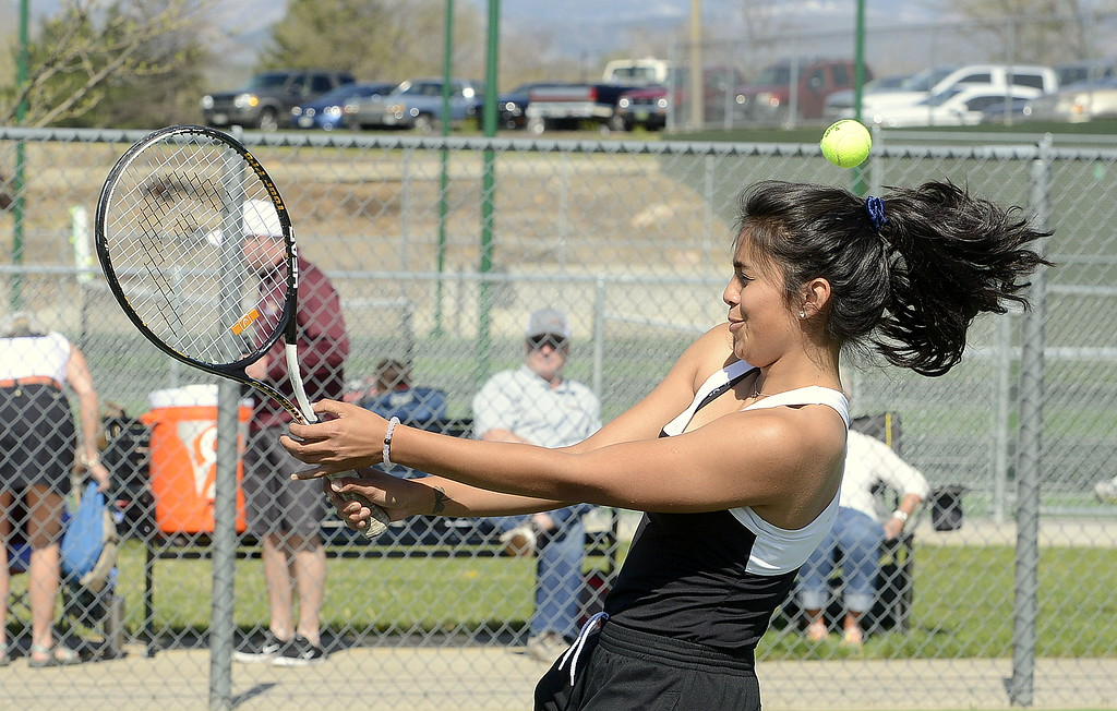 . Mountain View No. 4 doubles player Janette Perez gets hit by a shot during Friday\'s 4A Region 4 tournament at North Lake Park. (Mike Brohard/Loveland Reporter-Herald)