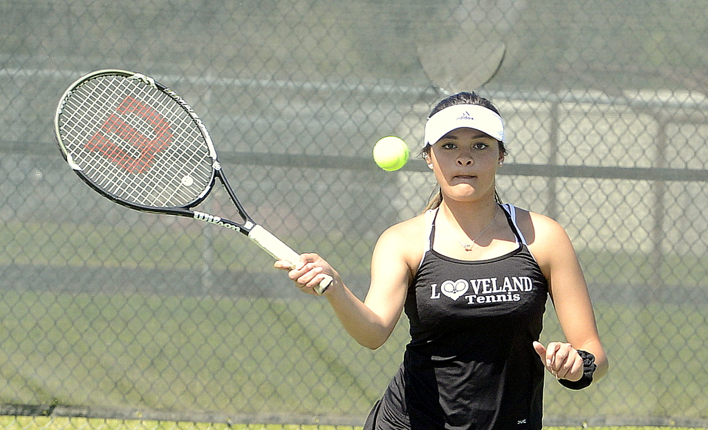 . Loveland\'s Alisa Sautter is all focus as she comes in for a forehand return in the championship match at No. 4 doubles during the 4A Region 4 tournament at North Lake Park. (Mike Brohard/Loveland Reporter-Herald)
