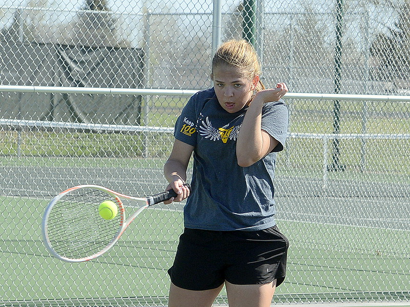 Thompson Valley No. 3 singles player Anna Cormos returns a shot Friday at the 4A Region 4 tournament at North Lake Park. (Mike Brohard/Loveland Reporter-Herald)