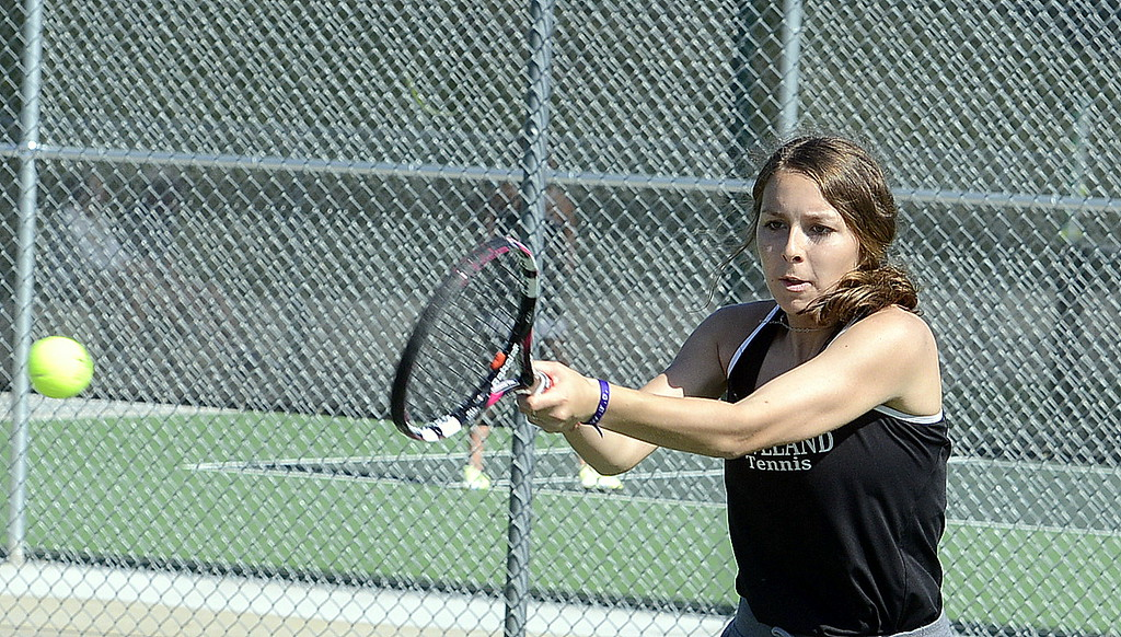 . Loveland No. 1 doubles player Heather Price hits a backhand return Friday at the 4A Region 4 tournament at North Lake Park. (Mike Brohard/Loveland Reporter-Herald)