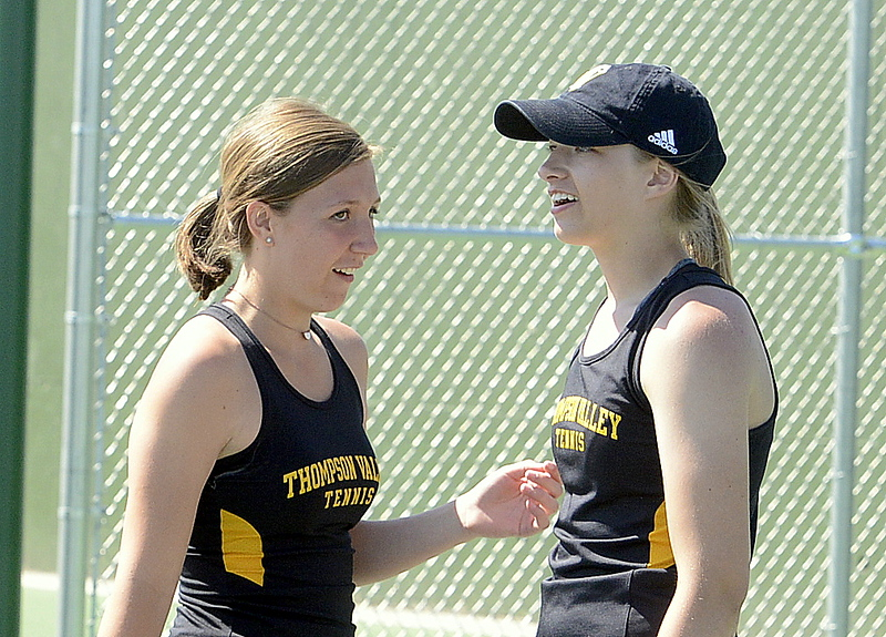 . Thompson Valley\'s No. 4 doubles team of Autumn Porter (left) and Sydney Laws chat between points during Friday\'s 4A Region 4 tournament at North Lake Park. (Mike Brohard/Loveland Reporter-Herald)