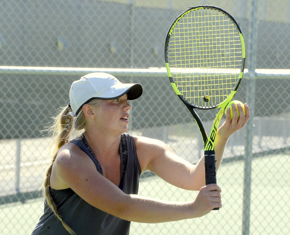. Maddie Sheets of Thompson Valley eyes her spot as she prepares to serve during her No. 1 singles championship match Friday at the 4A Region 4 tournament at North Lake Park. (Mike Brohard/Loveland Reporter-Herald)