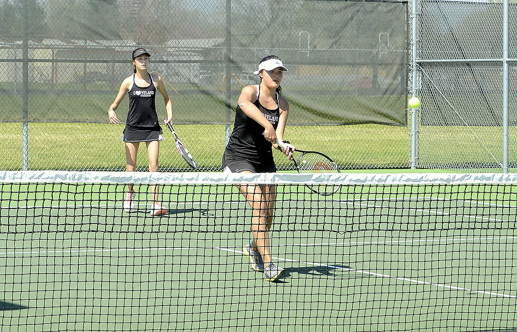 . Loveland\'s Alisa Sautter comes in to return a shot as No. 4 doubles partner Tara Jeffries looks on during their championship match at the 4A Region 4 tournament at North Lake Park. The duo lost to Windsor 6-3, 3-6, 6-4. (Mike Brohard/Loveland Reporter-Herald)